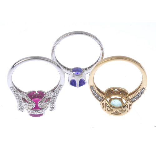 1373 - (133741) Three gold gem-set and diamond dress rings. To include a tanzanite and diamond dress ring, ...