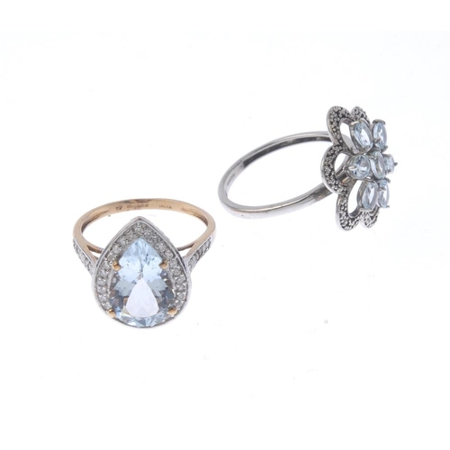 1374 - (133741) Two 9ct gold aquamarine and diamond dress rings. To include an aquamarine and diamond clust...