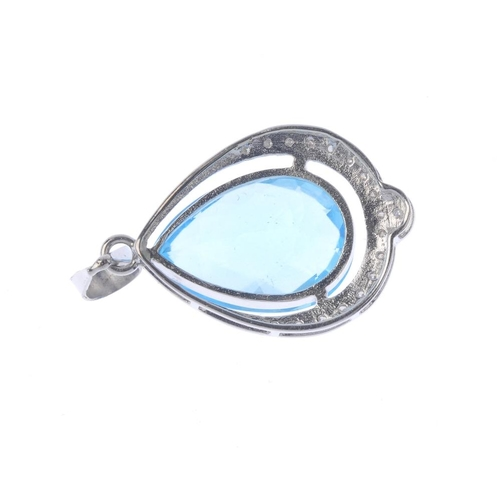 1377 - (203799) A synthetic spinel pendant. The pear-shape blue synthetic spinel, with single-cut diamond s...