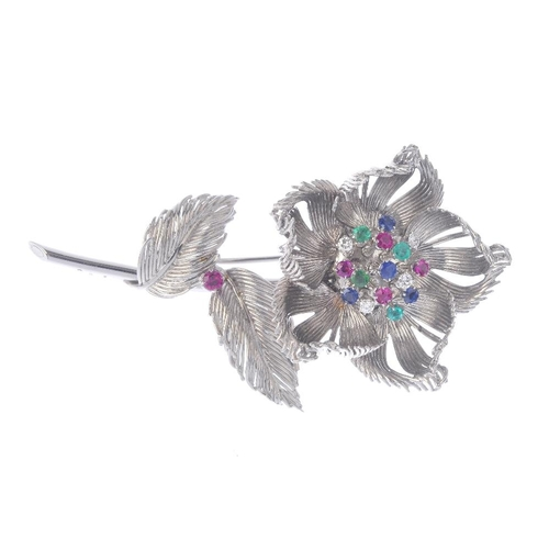 1381 - (203799) CARTIER - a 1960s gem-set brooch. Designed as a flower, with brilliant-cut diamond, circula...