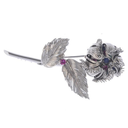 1381 - (203799) CARTIER - a 1960s gem-set brooch. Designed as a flower, with brilliant-cut diamond, circula...