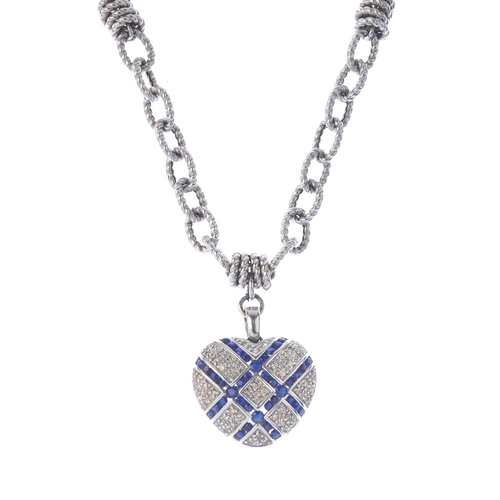 1384 - (203799) A sapphire and diamond pendant. The pave-set diamond circular-shape sapphire heart-shape pe...