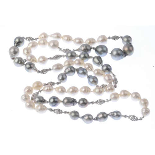 1386 - (203799) A freshwater cultured baroque pearl and diamond necklace. The freshwater cultured baroque p...