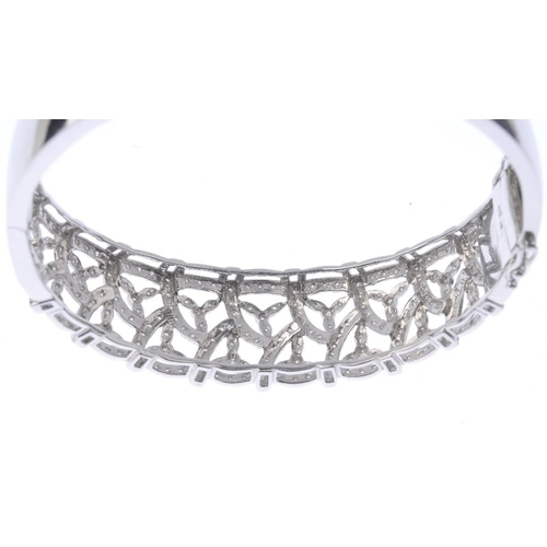 1388 - (203799) A diamond bangle. Of openwork design, the single-cut diamond foliate lattice, to the plain ...