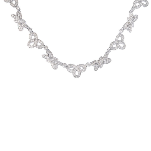 1389 - (203799) A diamond necklace. The brilliant-cut diamond openwork links, with similarly-cut diamond co...