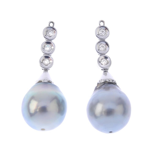 1392 - (203799) A pair of cultured pearl and diamond jewellery components. Each designed as a cultured pear...