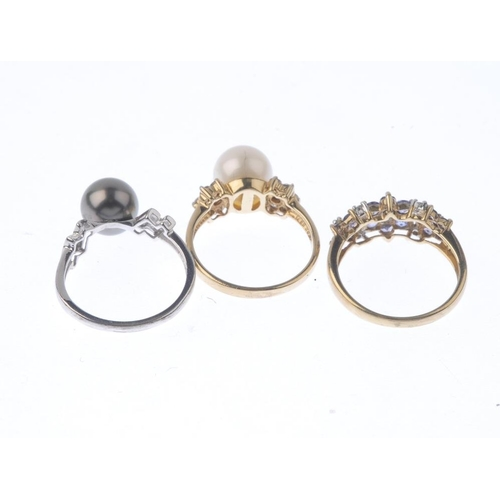 1395 - (62126) Three 9ct gold gem-set dress rings. To include two cultured pearl dress rings, together with...