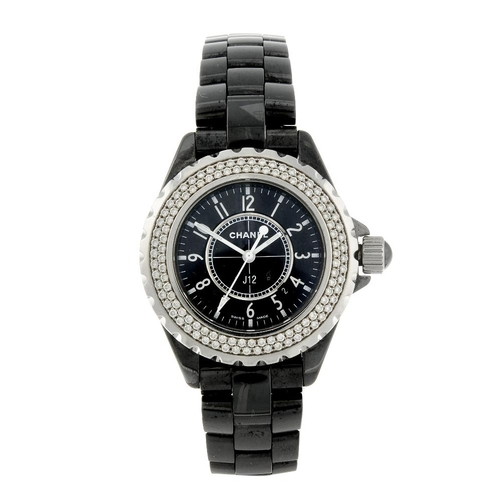 1401 - (203344) CHANEL - a lady's J12 bracelet watch. Ceramic case with stainless steel case back and facto...