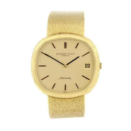 1417 - (131384-1-A) AUDEMARS PIGUET - a gentleman's yellow metal bracelet watch. Numbered 69938. 98gms. <br...