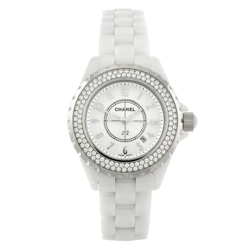 1421 - (131747-1-T) CHANEL - a lady's ceramic J12 bracelet watch. Numbered S.R.13672. Box and papers.  <br>...