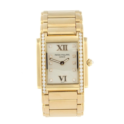1424 - (3750-1-A) PATEK PHILIPPE - a lady's diamond set 18ct rose gold Twenty-4 bracelet watch. Reference 4...