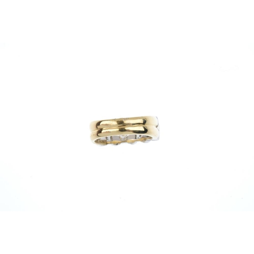 144 - An 18ct gold diamond band ring. Of bi-colour design, the two square-shape diamond lines, with groove...