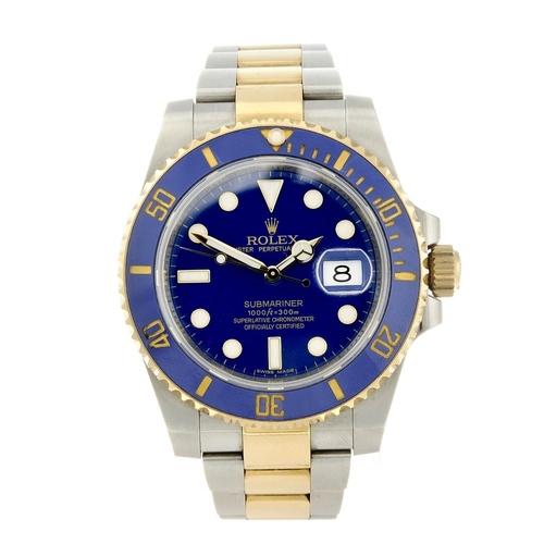 1446 - (401975-1-A) ROLEX - a gentleman's bi-metal Oyster Perpetual Date Submariner bracelet watch. Referen...