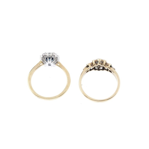 145 - Two sapphire and diamond dress rings. To include a 9ct gold sapphire and diamond floral cluster ring...