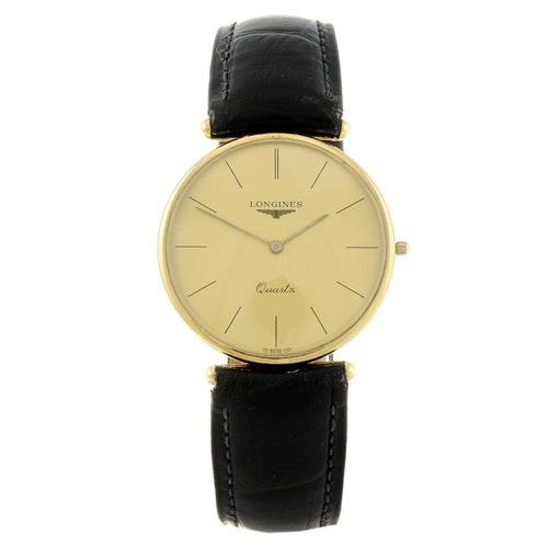 1453 - (547352-1-A) LONGINES - a gentleman's yellow metal wrist watch. Numbered 19878299, 01644.  <br>Fello...