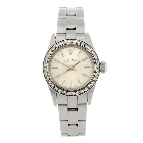 1463 - (550208-7-A) ROLEX - a lady's stainless steel Oyster Perpetual bracelet watch. Reference 67230, seri...