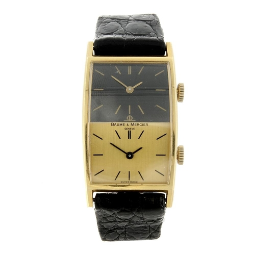 1464 - (550199-2-A) BAUME & MERCIER - a gentleman's yellow metal dual time wrist watch. Numbered 32002 7893...