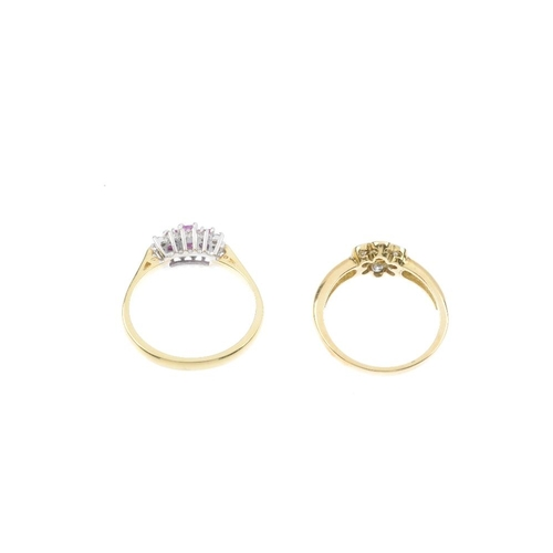 152 - Two 18ct gold ruby and diamond dress rings. The first designed as a circular-shape ruby and brillian...