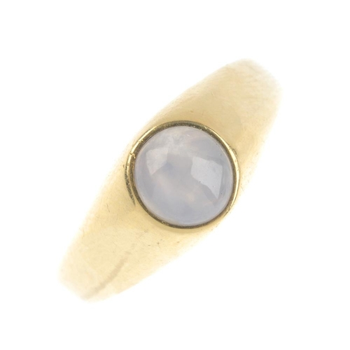 153 - A star sapphire single-stone ring. The circular star sapphire cabochon, inset to the tapered band. R...