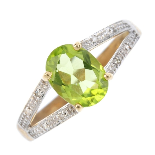 154 - A 9ct gold peridot and diamond dress ring. The oval-shape peridot, with pave-set single-cut diamond ...