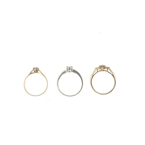 155 - Three 9ct gold diamond dress rings. To include two diamond cluster rings of geometric design, togeth...
