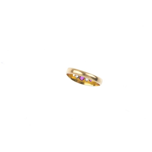 157 - A late Victorian 18ct gold ruby and diamond ring. The oval-shape ruby and old-cut diamond alternatin...