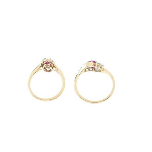 158 - Two 18ct gold ruby and diamond dress rings. The first designed as an oval-shape ruby, within a brill...
