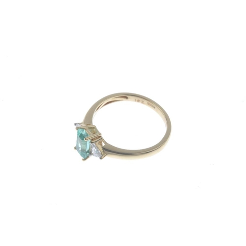16 - An 18ct gold Colombian emerald and diamond three-stone ring. The rectangular-shape Colombian emerald...