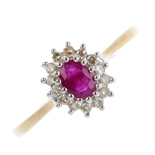 164 - A 9ct gold ruby and diamond cluster ring. The oval-shape ruby, with single-cut diamond surround. Est...
