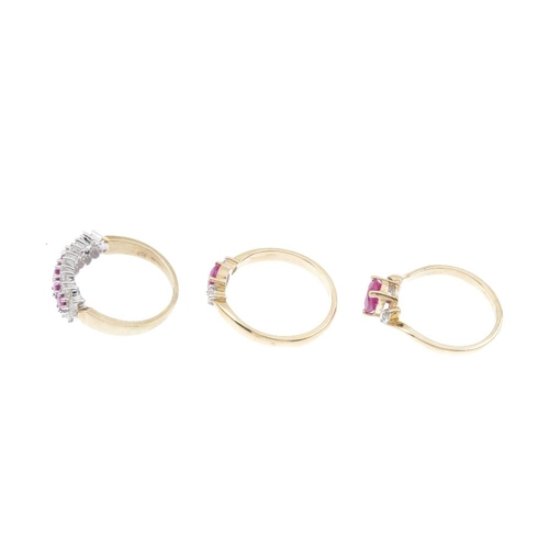 165 - Three 9ct gold diamond and ruby rings. To include a three-stone ring, a cluster ring, together with ...