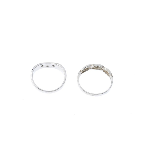 174 - Two 9ct gold diamond rings. To include a diamond chevron ring, together with a diamond scrolling ban...
