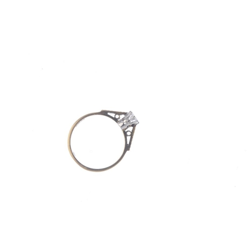 176 - A 9ct gold diamond single-stone ring. The brilliant-cut diamond, with tapered textured shoulders. Es...