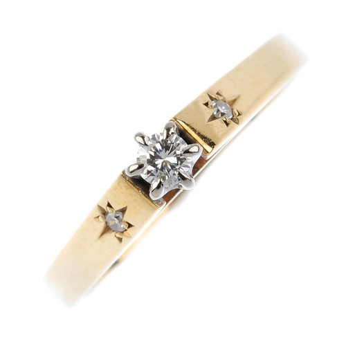 177 - A 9ct gold diamond ring. The brilliant-cut diamond, with similarly-cut diamond sides and tapered ban...