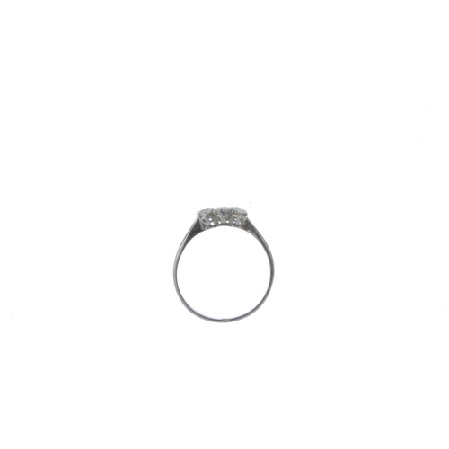 178 - A diamond three-stone ring. The graduated circular-shape diamond line, with tapered shoulders and pl...