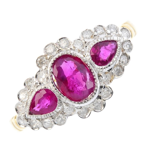 18 - An 18ct gold ruby and diamond dress ring. The oval and pear-shape ruby collets, within a brilliant-c...
