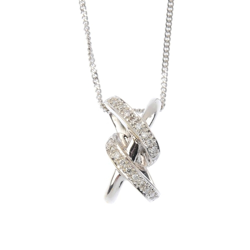 180 - An 18ct gold diamond pendant. The diagonal polished line, with brilliant-cut diamond line scrolling ...