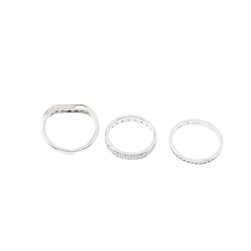 181 - Three 9ct gold diamond eternity rings. To include a diamond chevron ring, and two diamond full-circl...