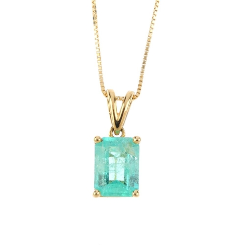 182 - An 18ct gold Colombian emerald single-stone pendant. The rectangular-shape Colombian emerald, suspen...