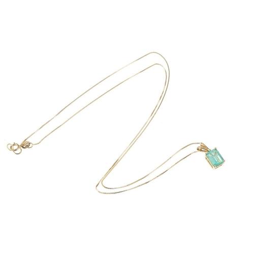 182 - An 18ct gold Colombian emerald single-stone pendant. The rectangular-shape Colombian emerald, suspen...