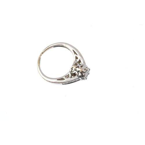 184 - A diamond cluster ring. The brilliant-cut diamond cluster, with square-shape diamond sides and plain...