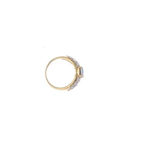 187 - An aquamarine and diamond ring. The rectangular-shape aquamarine, with brilliant-cut diamond panel s...