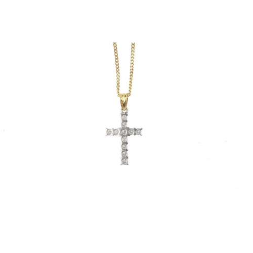 188 - An 18ct gold diamond cross pendant. The brilliant-cut diamond cross, with grooved tapered surmount, ...