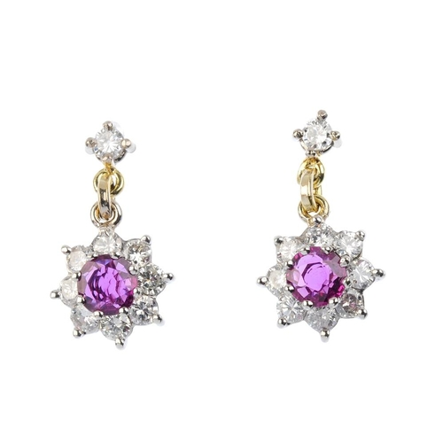 19 - A pair of 9ct gold ruby and diamond cluster earrings. Each designed as a circular-shape ruby, within...