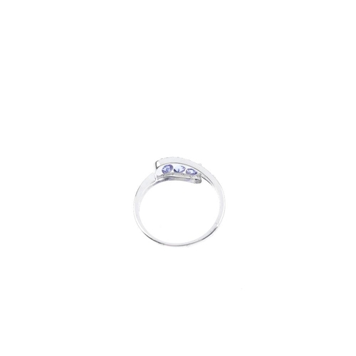 190 - A 9ct gold tanzanite and diamond dress ring. Designed as a series of three oval-shape tanzanite's, w...