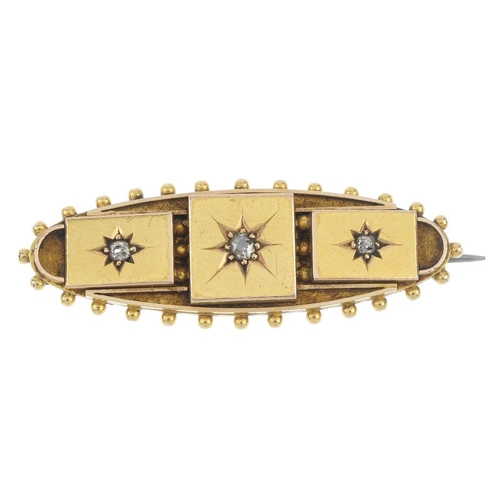 191 - A late Victorian 15ct gold diamond three-stone brooch, circa 1890. The old-cut diamond stars, within...
