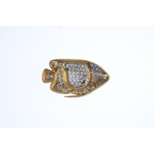 194 - A sapphire and diamond fish brooch. Designed as a pave-set sapphire tropical fish, with pave-set dia...
