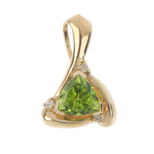 2 - A 9ct gold peridot and diamond pendant. The triangular-shape peridot, within a brilliant-cut diamond...