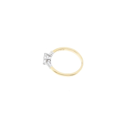 20 - An 18ct gold diamond single-stone ring. The square-shape diamond, with tapered baguette-cut diamond ...