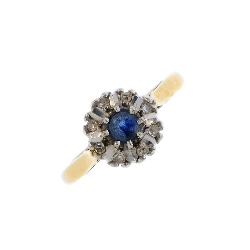 200 - An 18ct gold sapphire and diamond cluster ring. The circular-shape sapphire, with single-cut diamond...
