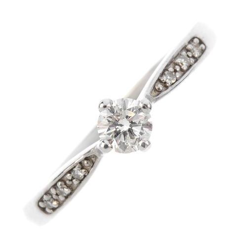 201 - A 9ct gold diamond single-stone ring. The brilliant-cut diamond, with single-cut diamond shoulders. ...